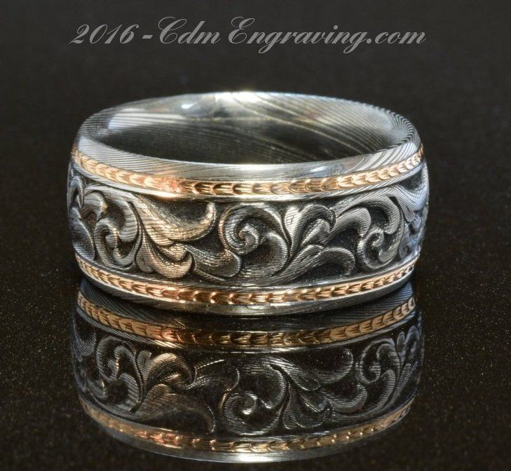 hand engraved wedding band in damascus and 18k rose gold