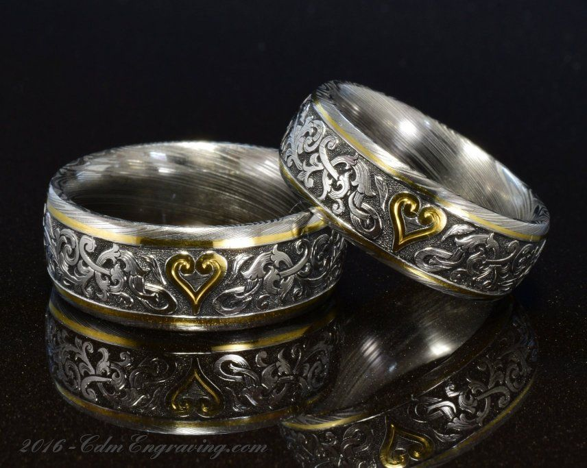 Hand engraved wedding bands in damascus and 18k gold